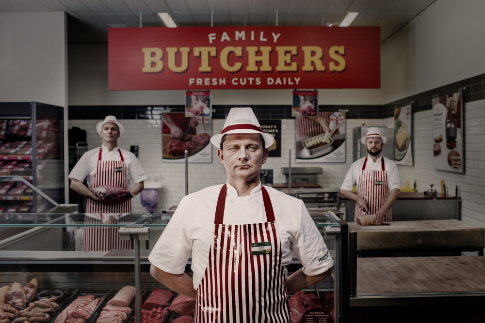 Butchery colleague stood in front of in-store deli