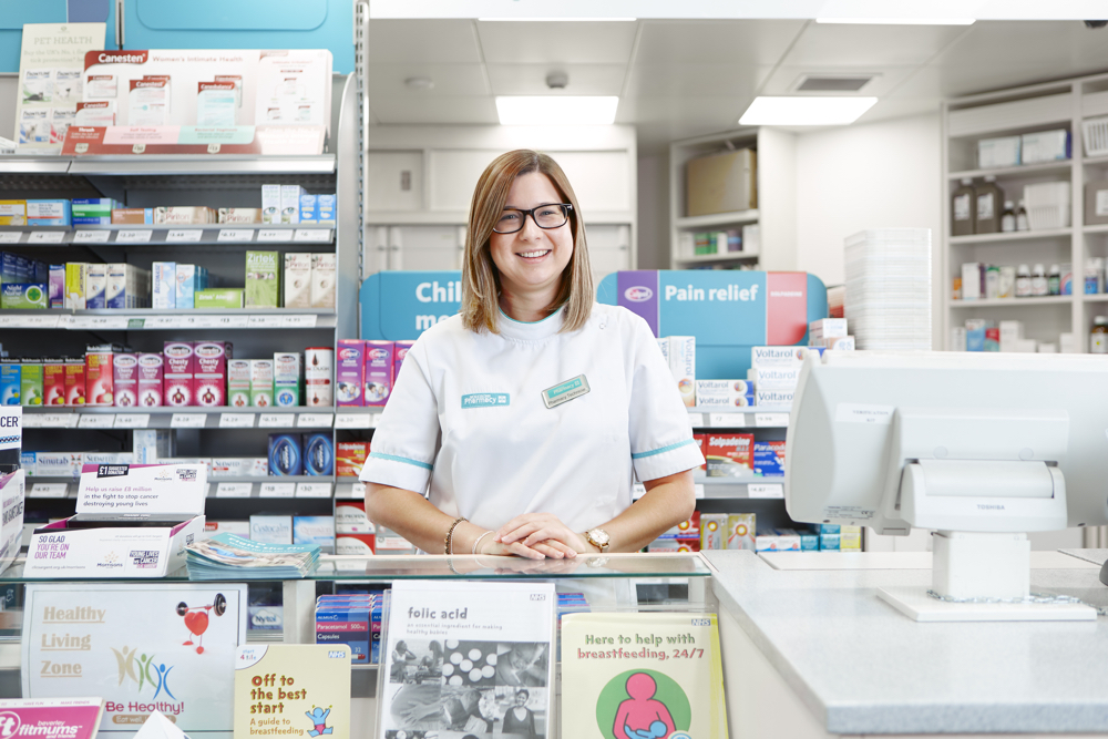 In-store Pharmacy colleague stood in front of Pharmacy