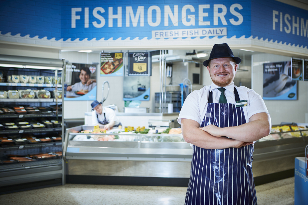Fishmonger standing in front of Market Street