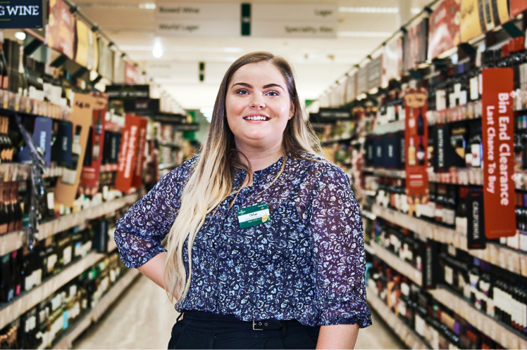 Chloe, a Morrisons Retail Graduate standing in store