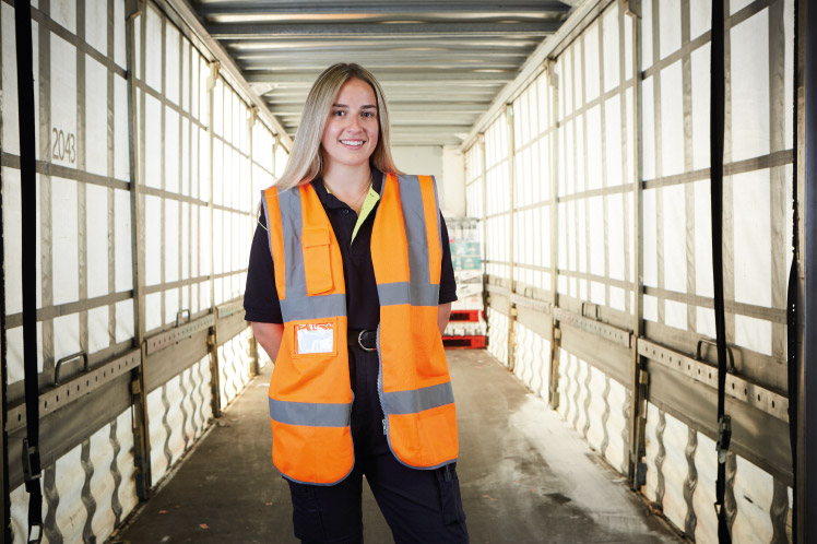 Lorna, Logistics degree apprentice standing in warehouse